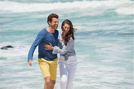 Couple enjoying on the beach Stock Photo - Premium Royalty-Free, Code: 6108-06905473