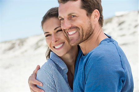 Close-up of a happy couple on the beach Stock Photo - Premium Royalty-Free, Code: 6108-06905478