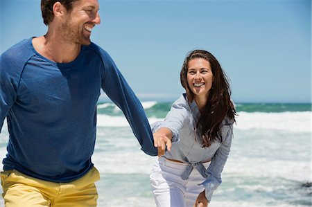 Couple enjoying on the beach Stock Photo - Premium Royalty-Free, Code: 6108-06905481