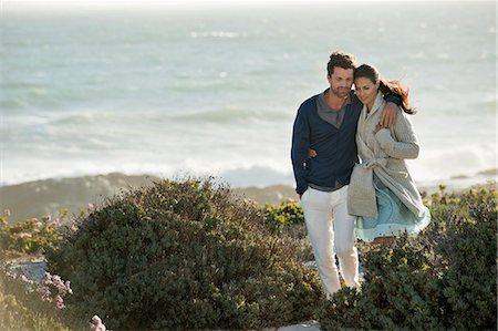 Couple walking on the beach Stock Photo - Premium Royalty-Free, Code: 6108-06905487