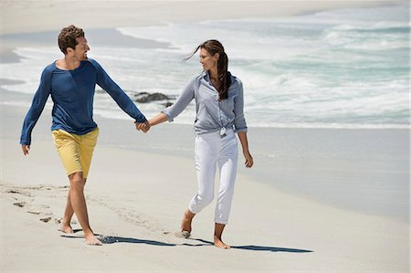 Couple enjoying on the beach Stock Photo - Premium Royalty-Free, Code: 6108-06905486