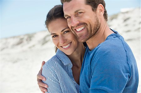 smiling - Close-up of a happy couple on the beach Stock Photo - Premium Royalty-Free, Code: 6108-06905493