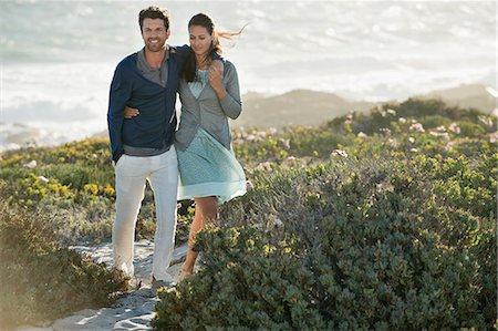 Couple walking on the beach Stock Photo - Premium Royalty-Free, Code: 6108-06905491