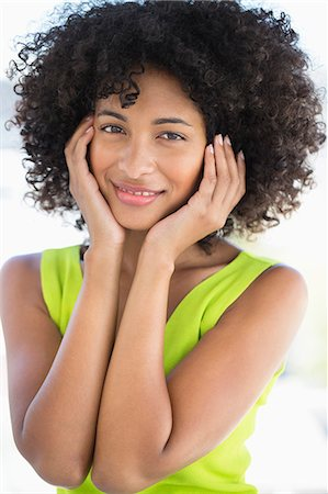 Portrait of a woman smiling Stock Photo - Premium Royalty-Free, Code: 6108-06905545