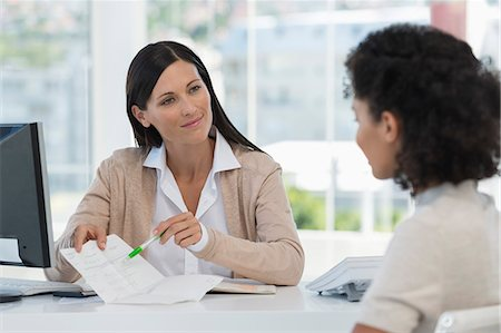 Female doctor showing medical report to a patient Stock Photo - Premium Royalty-Free, Code: 6108-06905655