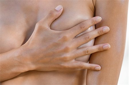 Woman hiding her breast with her hand Stock Photo - Premium Royalty-Free, Code: 6108-06905663