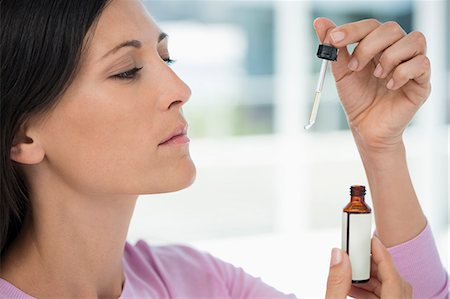drop - Close-up of a woman taking homeopathic medicine Stock Photo - Premium Royalty-Free, Code: 6108-06905666