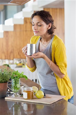 smelling - Woman smelling herbal tea Stock Photo - Premium Royalty-Free, Code: 6108-06905698
