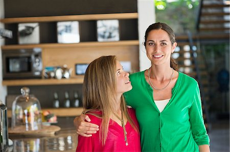 Close-up of a woman smiling with her daughter Stock Photo - Premium Royalty-Free, Code: 6108-06905604