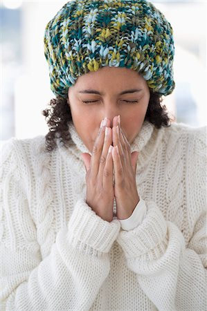 people coughing or sneezing - Close-up of a woman blowing her nose Stock Photo - Premium Royalty-Free, Code: 6108-06905637