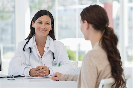 doctor and patient - Female doctor discussing with a patient Stock Photo - Premium Royalty-Free, Code: 6108-06905634