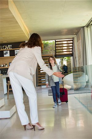 Woman welcoming her daughter arriving from holidays Stock Photo - Premium Royalty-Free, Code: 6108-06905757