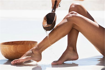 female feet close up - Woman bathing on the beach Stock Photo - Premium Royalty-Free, Code: 6108-06905771