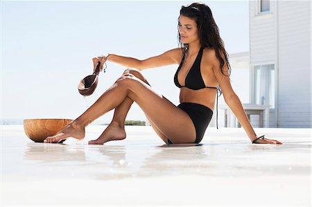 Beautiful woman bathing on the beach Stock Photo - Premium Royalty-Free, Code: 6108-06905793