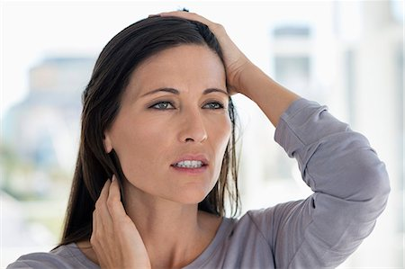 Close-up of a woman suffering from a headache Stock Photo - Premium Royalty-Free, Code: 6108-06905703