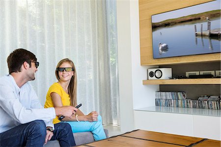 Man and his daughter watching a 3D movie Stock Photo - Premium Royalty-Free, Code: 6108-06905723