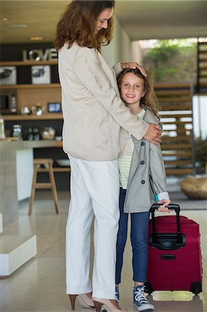 Woman welcoming her daughter arriving from holidays Stock Photo - Premium Royalty-Free, Code: 6108-06905727