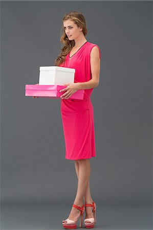 Woman carrying boxes Stock Photo - Premium Royalty-Free, Code: 6108-06905879