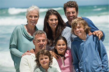 Portrait of a family smiling on the beach Stock Photo - Premium Royalty-Free, Code: 6108-06905893