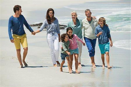 Family walking on the beach Stock Photo - Premium Royalty-Free, Code: 6108-06905895