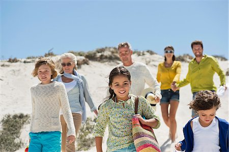 Family walking on the beach Stock Photo - Premium Royalty-Free, Code: 6108-06905896