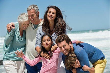 Family smiling on the beach Stock Photo - Premium Royalty-Free, Code: 6108-06905898