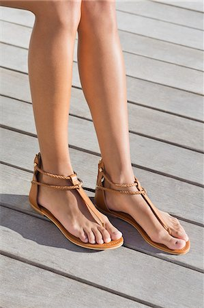 female feet close up - Low section view of a woman wearing sandals Stock Photo - Premium Royalty-Free, Code: 6108-06905802