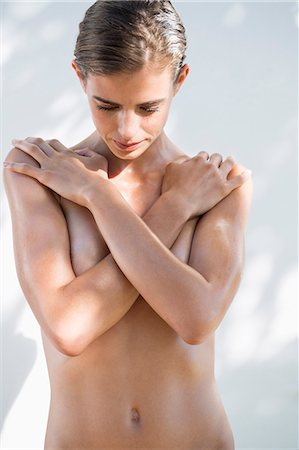 sexy - Woman hiding her breast with her hands Stock Photo - Premium Royalty-Free, Code: 6108-06905809