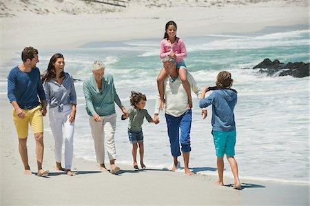 Family enjoying on the beach Stock Photo - Premium Royalty-Free, Code: 6108-06905947