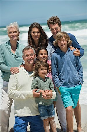 Portrait of a family smiling on the beach Stock Photo - Premium Royalty-Free, Code: 6108-06905900