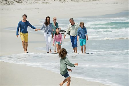 Family enjoying on the beach Stock Photo - Premium Royalty-Free, Code: 6108-06905907