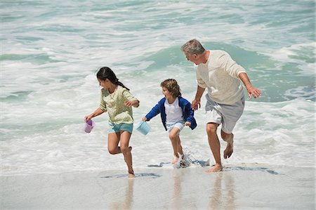 families playing on the beach - Children playing with their grandfather on the beach Stock Photo - Premium Royalty-Free, Code: 6108-06905904