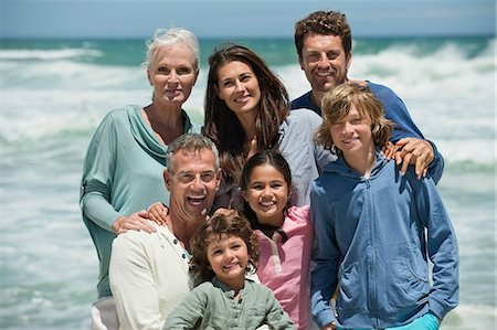 Portrait of a family smiling on the beach Stock Photo - Premium Royalty-Free, Code: 6108-06905913