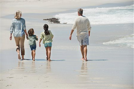 Children walking with their grandparents on the beach Stock Photo - Premium Royalty-Free, Code: 6108-06905930