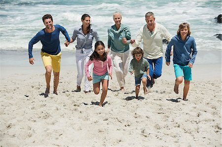 Family running on the beach Stock Photo - Premium Royalty-Free, Code: 6108-06905936