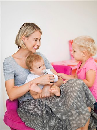 sucking - Smiling mother with her children Stock Photo - Premium Royalty-Free, Code: 6108-06906067