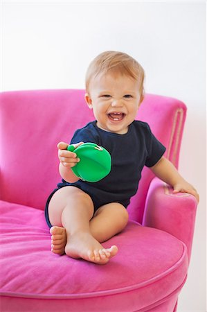 Baby boy playing with a pouch bag Stock Photo - Premium Royalty-Free, Code: 6108-06906097