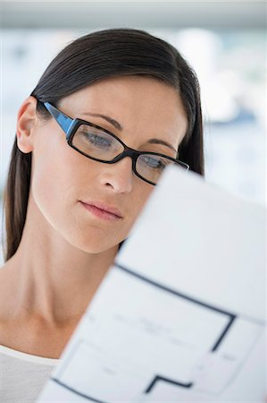 design - Close-up of a woman reading a document Stock Photo - Premium Royalty-Free, Code: 6108-06906175