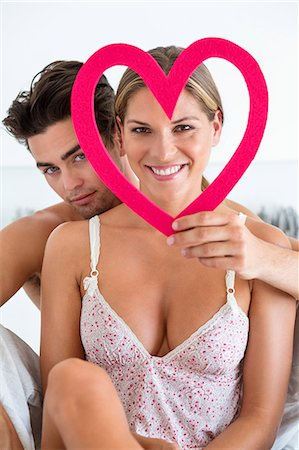 Couple with a heart shape object Stock Photo - Premium Royalty-Free, Code: 6108-06906205