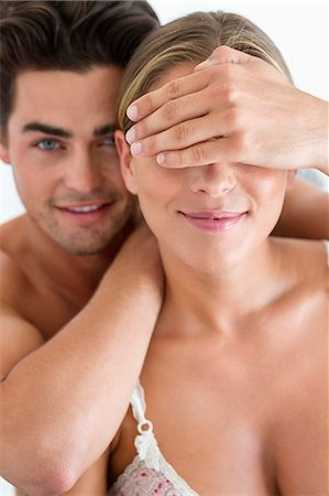 Man covering eyes of his girlfriend Stock Photo - Premium Royalty-Free, Code: 6108-06906212
