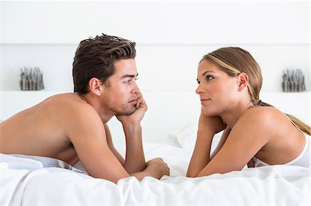 romantic couple bed - Couple lying face to face on the bed Stock Photo - Premium Royalty-Free, Code: 6108-06906215