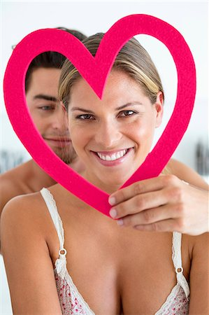 red - Couple with a heart shape object Stock Photo - Premium Royalty-Free, Code: 6108-06906233