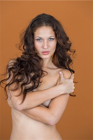 female nude breast sexy - Portrait of a naked woman posing Stock Photo - Premium Royalty-Free, Code: 6108-06906468