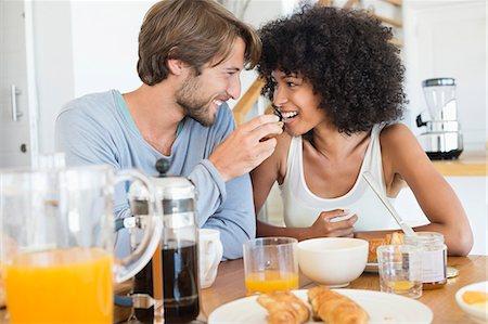 Man feeding food to her wife Stock Photo - Premium Royalty-Free, Code: 6108-06906410