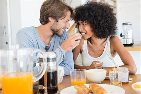 Man feeding food to her wife Stock Photo - Premium Royalty-Free, Code: 6108-06906410