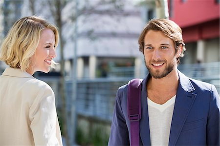 flirting - Close-up of a man and woman smiling Stock Photo - Premium Royalty-Free, Code: 6108-06906576