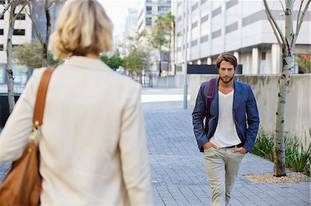 flirting - Man and woman walking on a street Stock Photo - Premium Royalty-Free, Code: 6108-06906512