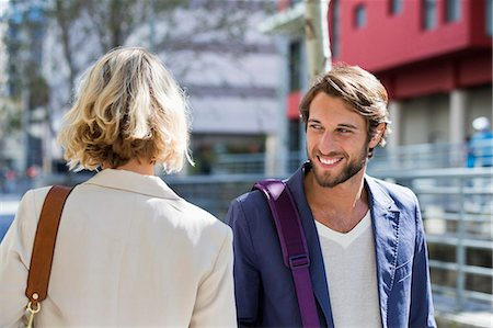 flirting - Man flirting a woman and smiling Stock Photo - Premium Royalty-Free, Code: 6108-06906517