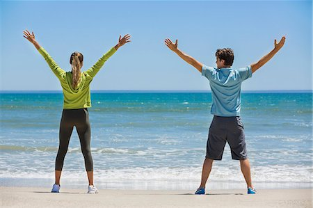 stretching (people exercising) - Woman exercising on the beach with her coach Stock Photo - Premium Royalty-Free, Code: 6108-06906615