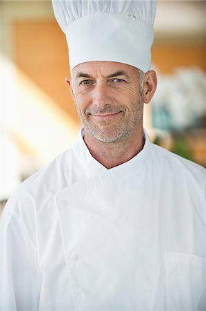 Portrait of a chef smiling Stock Photo - Premium Royalty-Free, Code: 6108-06906764